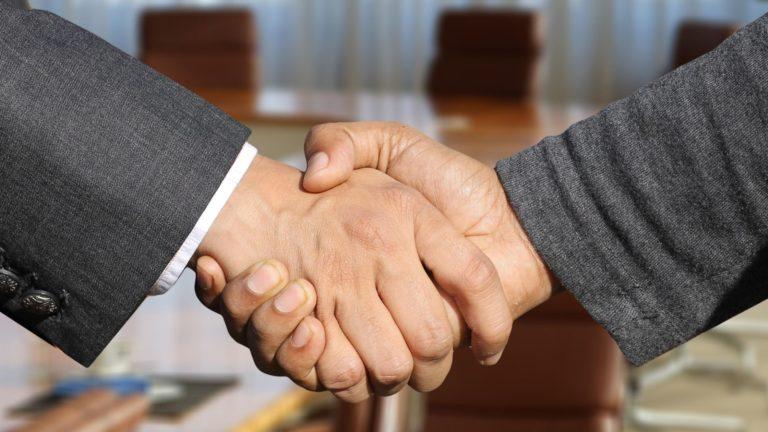 Biden Medicaid Handshake