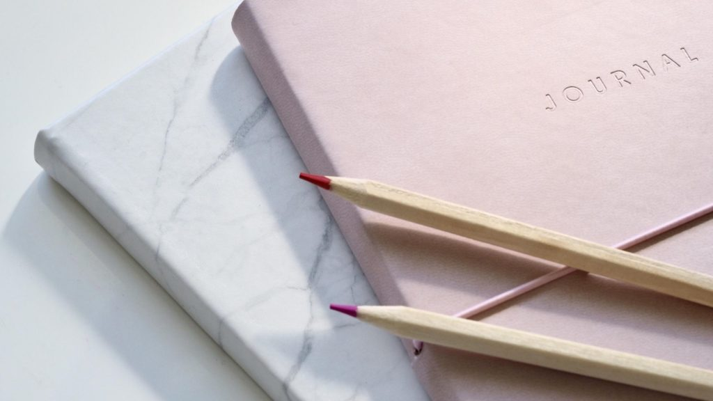 estate planning basics journal and pencils
