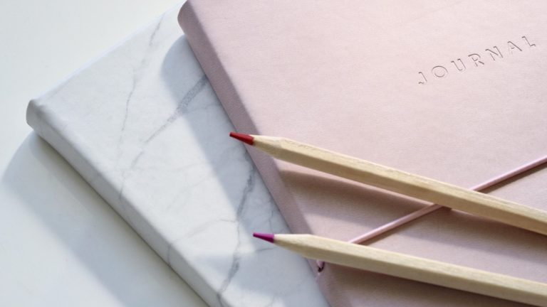 estate planning basics journal and pencils